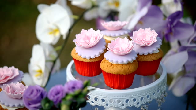sweet wedding cake made from cupcake. - cupcake stock videos & royalty-free footage