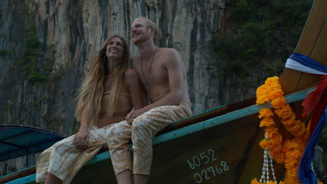 sweet young couple age 25-29 yearold of latin american and hispanic ethnicity wearing tie dye look at view to enjoying travel holidays to romantic on taxi boat on the island a tropical climate together.travel concept - wonderlust stock videos & royalty-free footage