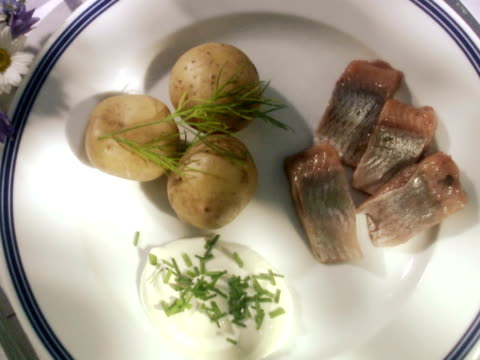 sweet-pickled herring new potatoes sour cream and chives sweden. - sour cream stock videos & royalty-free footage