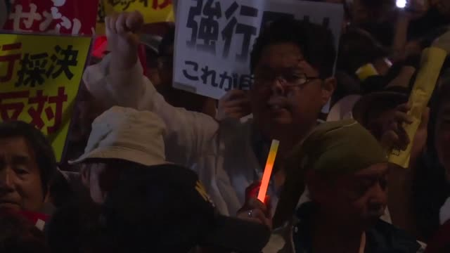 Swelling crowds gather outside Japans parliament as lawmakers looked close to passing security bills that could see Japanese troops fight abroad for...