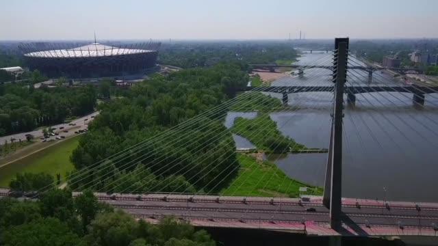 swietokrzyski bridge and national stadium in warsaw - cable stayed bridge stock videos & royalty-free footage