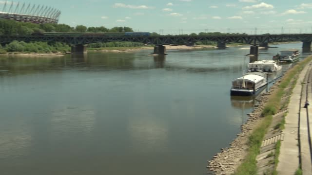 swietokrzyski bridge and vistula river in warsaw - barge stock videos & royalty-free footage