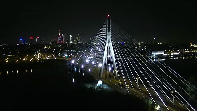 swietokrzyski bridge in warsaw by night - cable stayed bridge stock videos & royalty-free footage