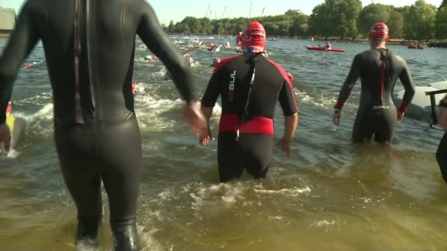 swim serpentine at hyde park raising money for charity england london hyde park serpentine ext dan lawrence along and diving into lake along with... - swimming stock videos & royalty-free footage