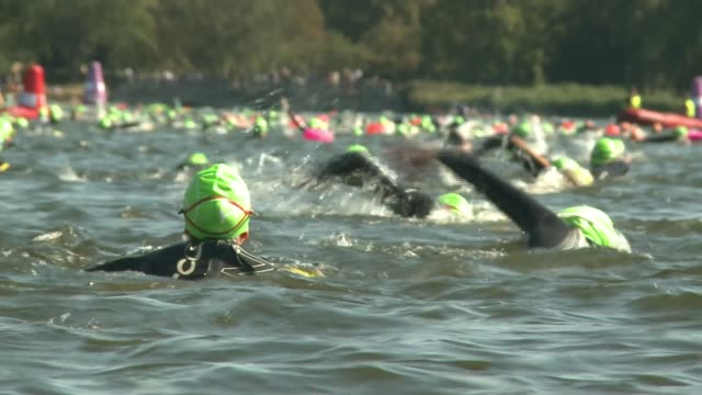 swim serpentine at hyde park raising money for charity; england: london: hyde park: serpentine: ext swimmers running along platform and diving into... - diving platform stock videos & royalty-free footage