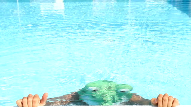 swimmer in a frog costume - swimming costume stock videos and b-roll footage