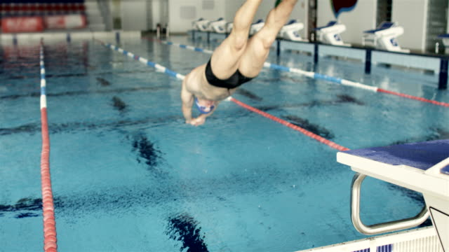 Swimmer Jumping Into The Water