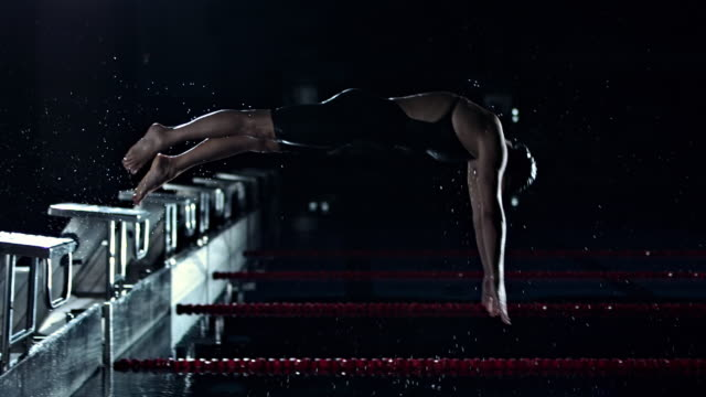 Swimmer Jumping Off The Starting Block