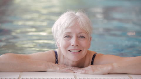 cu swimmer resting at the edge of a pool / vancouver, british columbia, canada - grey hair stock videos & royalty-free footage