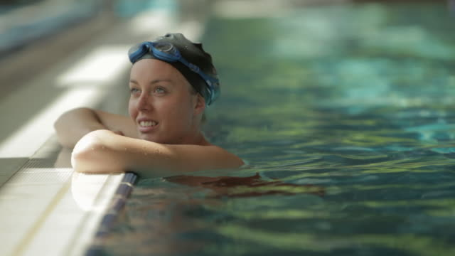 ms swimmer resting on side of pool / vancouver, british columbia, canada - swimming cap stock videos and b-roll footage