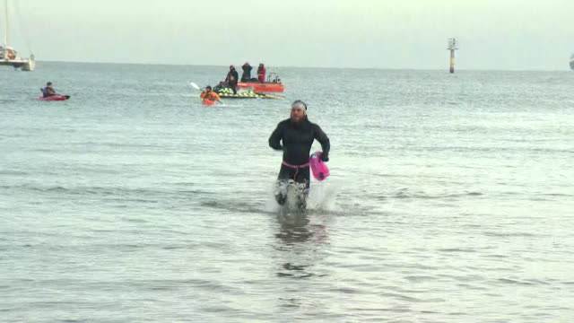 swimmer ross edgley arriving at margate beach after becoming the first person to swim around great britain - swimming stock videos & royalty-free footage