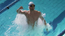 Swimmer training in a swimming pool