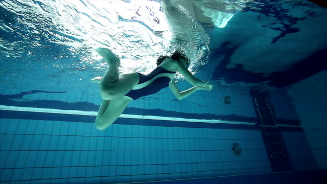 Swimmer training in the swimming pool