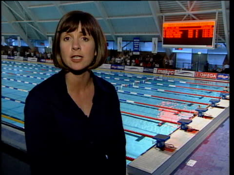 swimmers diving from blocks into lanes of swimming pool i/c swimmers at edge of pool people swimming in lanes electronic sign 'british swimming' on... - channel 4 news stock videos & royalty-free footage