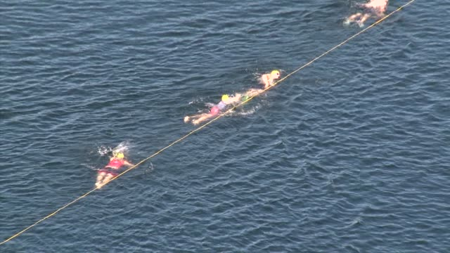 swimmers in lake in sos triathlon zoom out to show beautiful lake setting - new paltz ny stock videos and b-roll footage