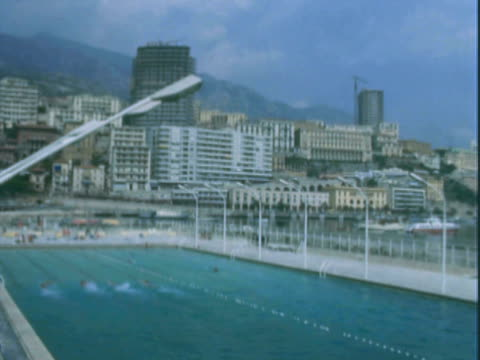 stockvideo's en b-roll-footage met montage swimmers in olympic-sized pool at resort complex / florence, italy - buitenbad