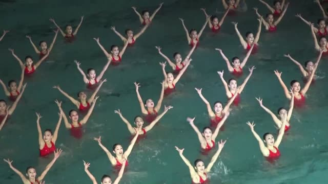 Swimmers perform in a synchronized swimming gala event in Pyongyang