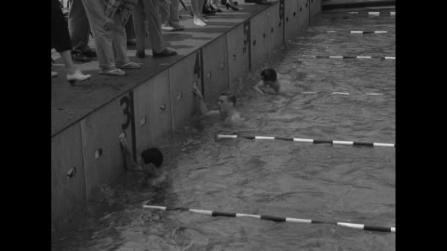 swimmers reach pool wall in 100meter freestyle race during olympic trials for the 1952 summer olympics / clark scholes of michigan state university... - yale university stock videos and b-roll footage