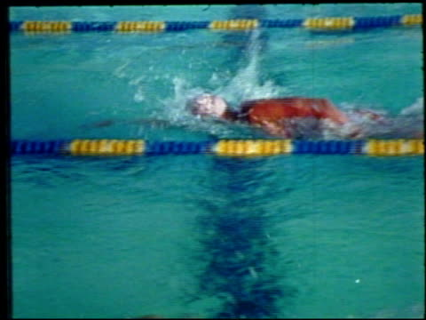 swimmers swimming in race, including athlete shirley babashoff, babashoff talking about trying to olympics , putting on cap & goggles, swimming w/... - nationalmannschaft stock-videos und b-roll-filmmaterial