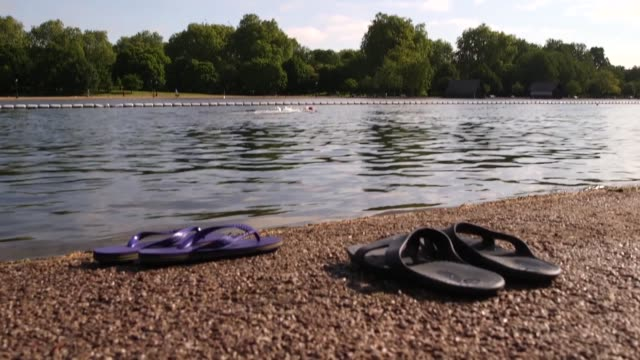 swimmers take the plunge into hyde park's serpentine lake in london after it was closed due to coronavirus the swimming club reopened on monday with... - the serpentine london stock videos & royalty-free footage