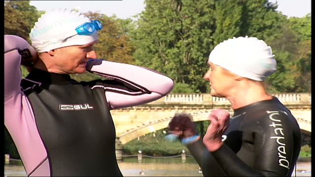 swimmers taking part in serpentine swim to raise money for breast cancer research england london hyde park serpentine ext people along at side of... - the serpentine london stock videos & royalty-free footage