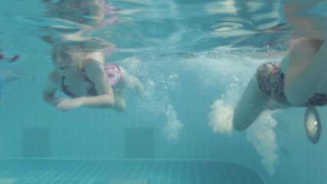 WS Swimmers underwater in pool / Vancouver, British Columbia, Canada