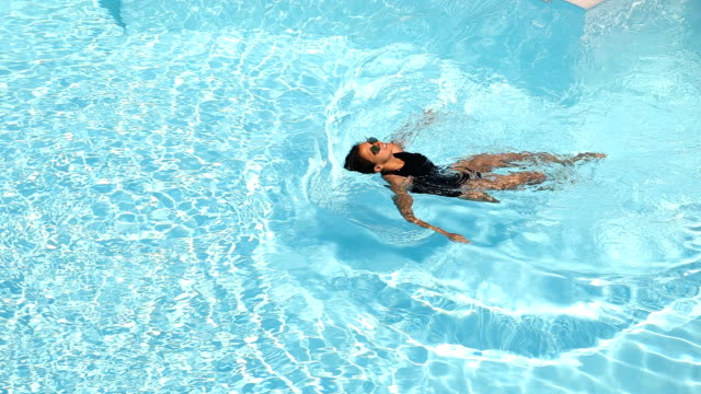 swimming at the resort - swimming costume stock videos & royalty-free footage