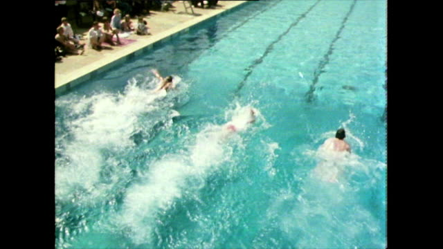 swimming competition at a holiday camp in devon; 1981 - swimming stock videos & royalty-free footage