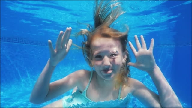 swimming funny girl making fun - in slowmotion - - swimwear stock videos & royalty-free footage