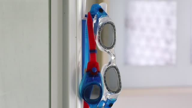 swimming goggles hanging in domestic bathroom - swimming goggles stock videos & royalty-free footage
