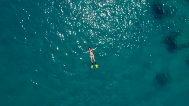 swimming in clear turquoise sea - lying down stock videos & royalty-free footage