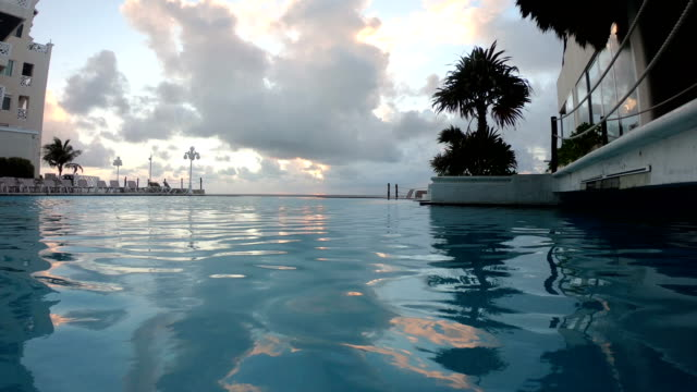 swimming in infinity pool of hotel in cancun mexico - infinity pool stock videos & royalty-free footage