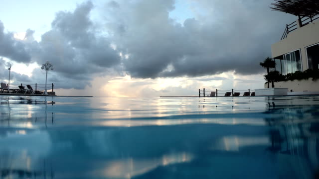 swimming in infinity pool of hotel in cancun mexico - mexico stock videos & royalty-free footage