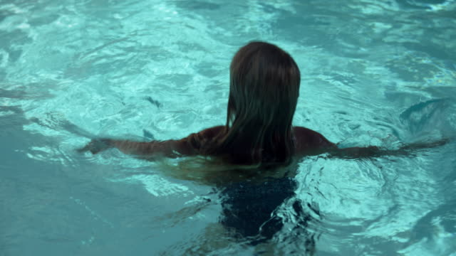 swimming in pool - swimwear stock videos & royalty-free footage