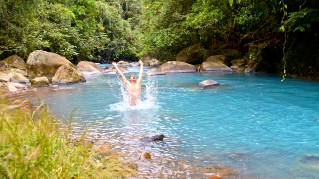 slo swimming in rio celeste - costa rica stock videos & royalty-free footage