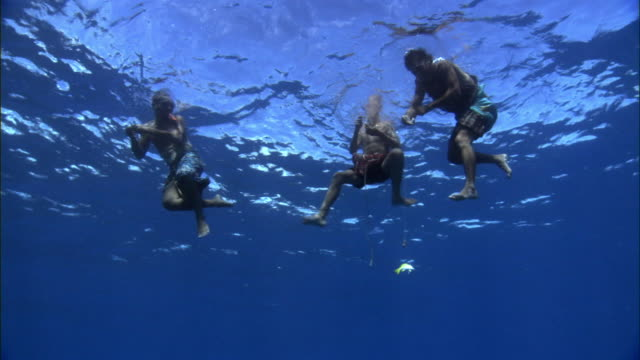 Swimming men fishing in open ocean anuta solomon islands stock swimming men fishing in open ocean anuta solomon islands stock footage video getty images thecheapjerseys Image collections