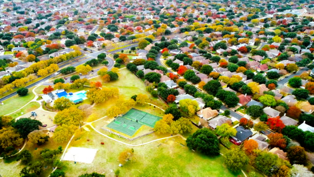 swimming pool and autumn suburb development - modern rock stock videos & royalty-free footage