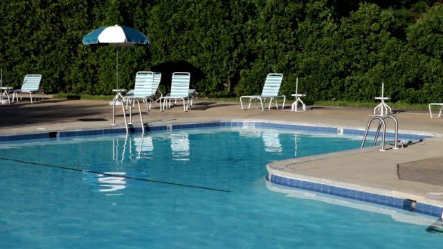 swimming pool and deck, no people - 3 scenes - lifeguard chair stock videos & royalty-free footage