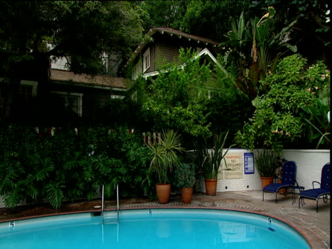 swimming pool below private bungalow chateau marmont sunset strip los angeles - outdoor chair stock videos and b-roll footage