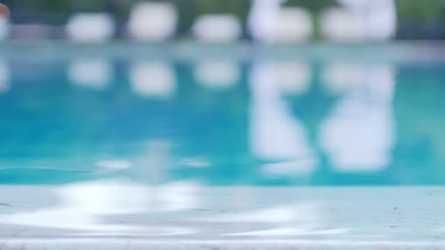swimming pool blurred for footage background - swimming pool stock videos & royalty-free footage