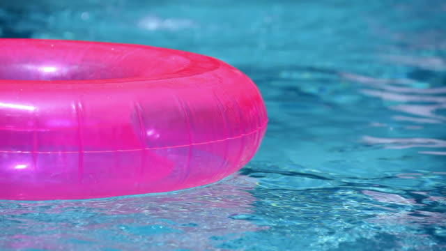 swimming pool float and ball - swimming pool stock videos & royalty-free footage