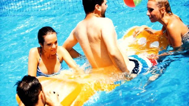 swimming pool fun. - toned image stock videos & royalty-free footage