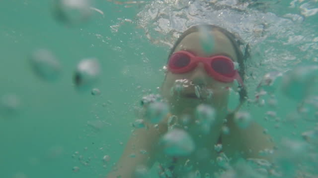 swimming pool girl - swimming goggles stock videos & royalty-free footage
