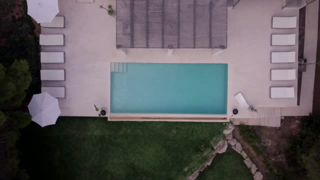 swimming pool in a luxury spanish villa - holiday villa stock videos & royalty-free footage