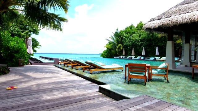 swimming pool in the ayada island - outdoor chair stock videos & royalty-free footage