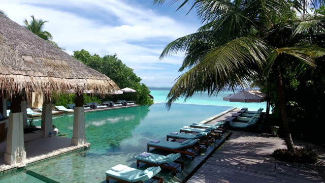 swimming pool in the ayada island - sunbed stock videos & royalty-free footage