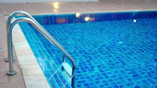 swimming pool ladders or swimming pool hand rails - standing water stock videos & royalty-free footage