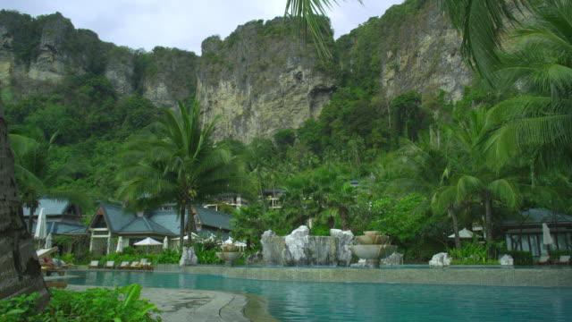 ws pan swimming pool of hotel resort in tropical surroundings, krabi, thailand - provinsen krabi bildbanksvideor och videomaterial från bakom kulisserna