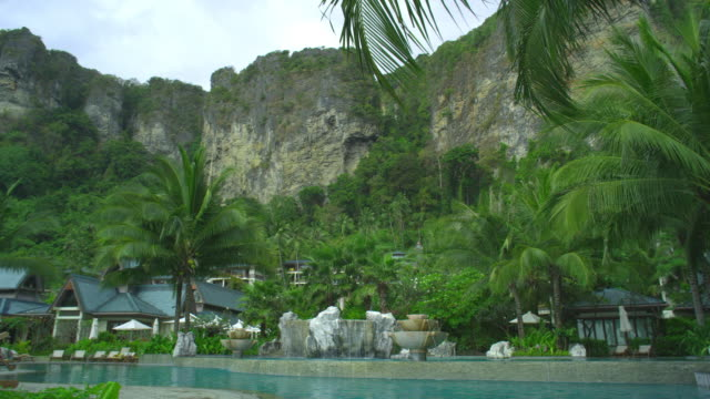 ws pan swimming pool of hotel resort in tropical surroundings, krabi, thailand - see other clips from this shoot 1459 stock videos and b-roll footage