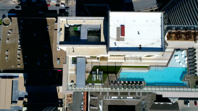 swimming pool on amazing rooftop on top of skyscrapers views high above austin , texas , usa aerial drone view - roof stock videos & royalty-free footage